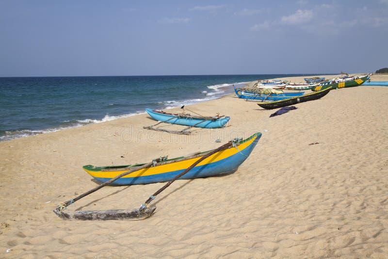 Dugout canoe in Batticaloa, Sri Lanka. Dugout canoe in Batticaloa beach, Sri Lanka royalty free stock photos
