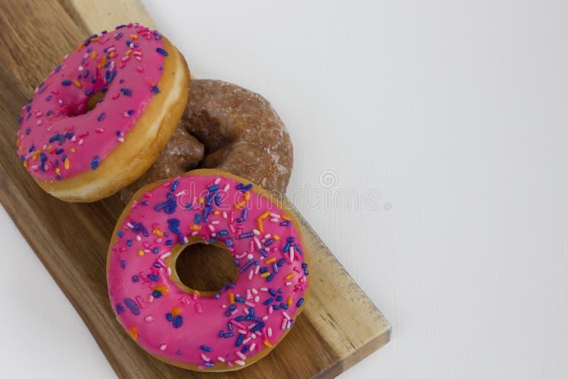 Duidelijke één en Roze Twee en Donuts royalty-vrije stock afbeelding