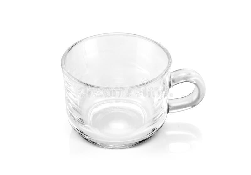 Duidelijke glaskop op witte achtergrond stock foto's