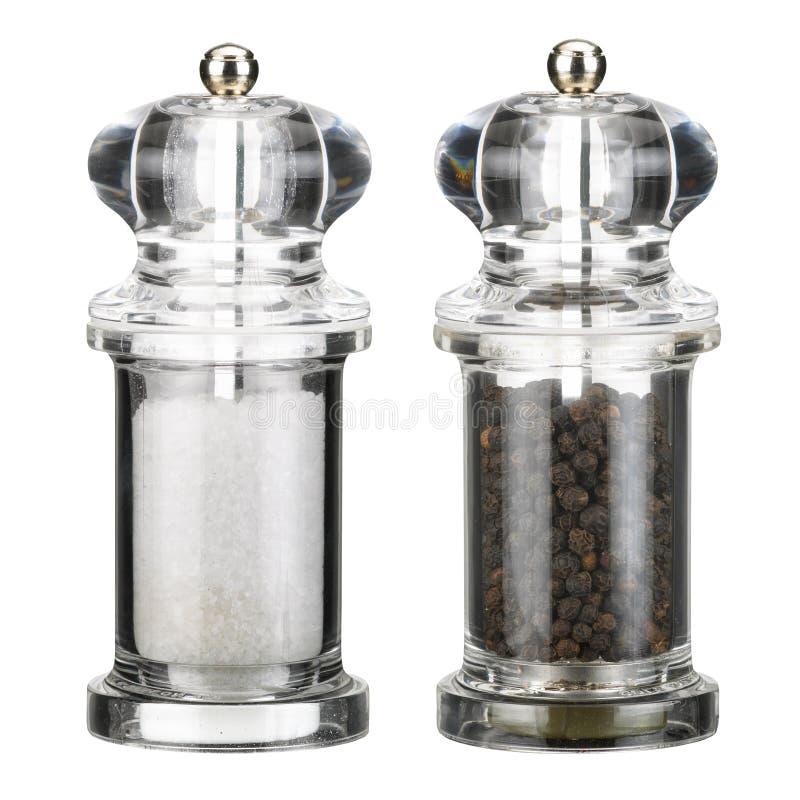 Duidelijke plastic zoute pepermolenmolens stock foto