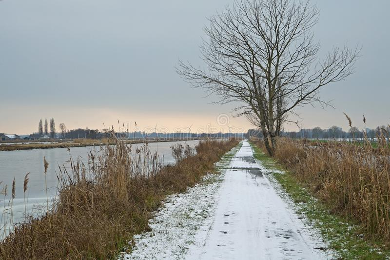 Duifpolder in wintertime with some snow and evening light a horizon. Duifpolder in wintertime with some snow and evening light at the horizon royalty free stock photo