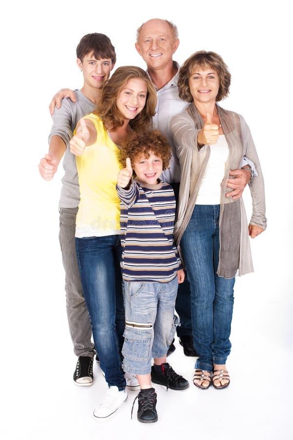 Duim-op familie het stellen in stijl stock foto's