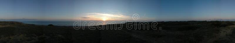 Duinen en zonsondergang royalty-vrije stock afbeelding