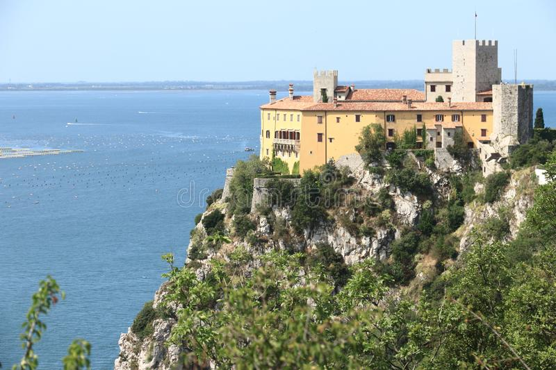 Duino castle in northern Italy. Duino Castle  is a fourteenth-century fortification located in Duino municipality of Duino-Aurisina, near Trieste, Italy, on the stock photos