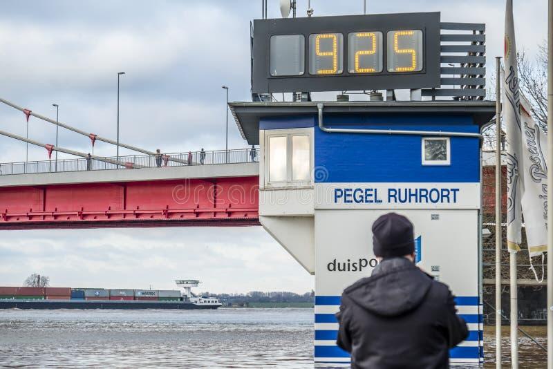 Duisburg , Germany - January 08 2017 : The flooding watermark is over 9 meters. DUISBURG , GERMANY - JANUARY 08 2017 : The flooding watermark is climbing over 9 stock photography