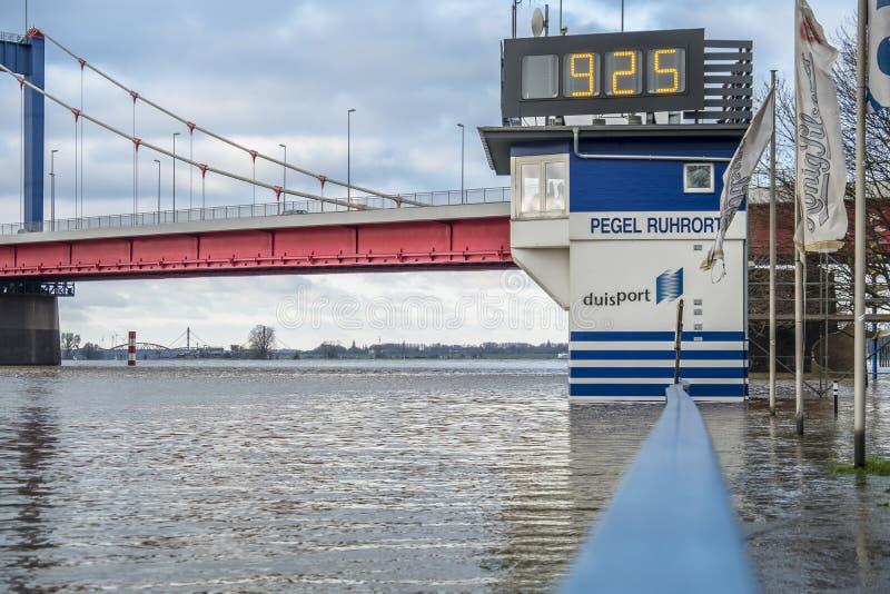 Duisburg , Germany - January 08 2017 : The flooding watermark is over 9 meters. DUISBURG , GERMANY - JANUARY 08 2017 : The flooding watermark is climbing over 9 stock images