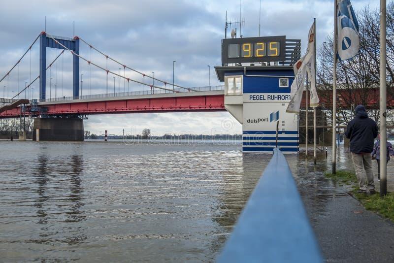 Duisburg , Germany - January 08 2017 : The flooding watermark is over 9 meters. DUISBURG , GERMANY - JANUARY 08 2017 : The flooding watermark is climbing over 9 royalty free stock image