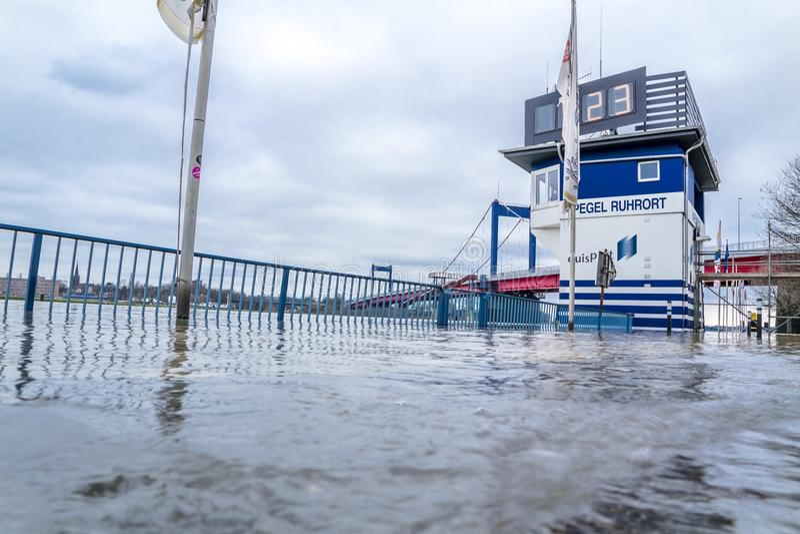 Duisburg , Germany - January 08 2017 : The flooding watermark is over 9 meters. DUISBURG , GERMANY - JANUARY 08 2017 : The flooding watermark is climbing over 9 stock photos