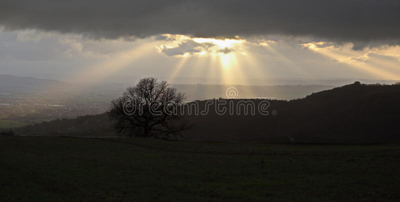 Duisternis en zonnestralen royalty-vrije stock foto