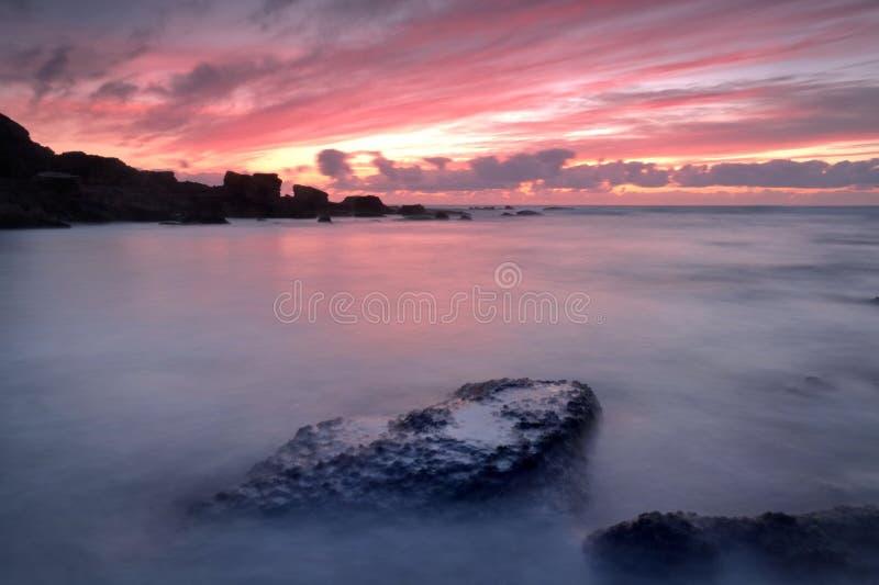 Duisternis op het strand stock afbeelding