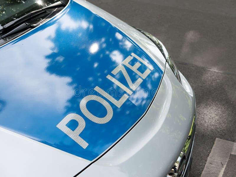 Duits Nieuwsconcept: Blauwe Politiewagen royalty-vrije stock foto