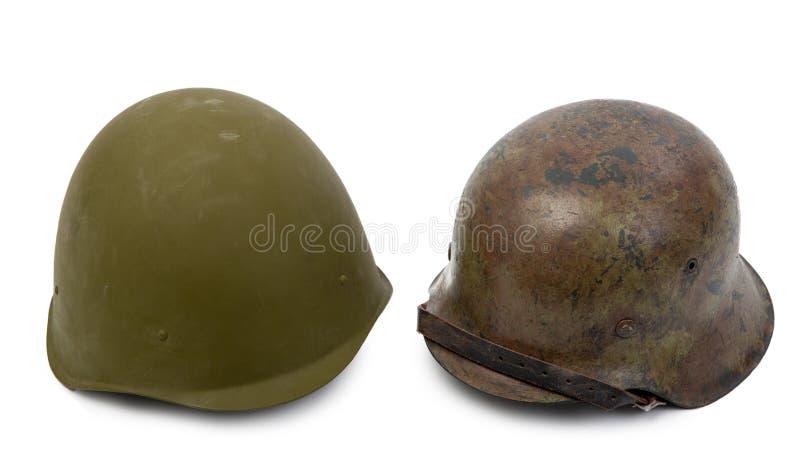 Duitse en Sovjethelmen op witte achtergrond stock afbeeldingen