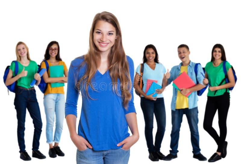 Duitse vrouwelijke student met blond haar en groep studenten royalty-vrije stock fotografie