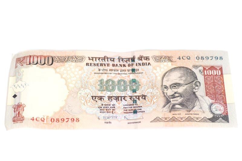 Duizend Roepiesnota (Indische die Munt) op witte bedelaars wordt geïsoleerd royalty-vrije stock foto