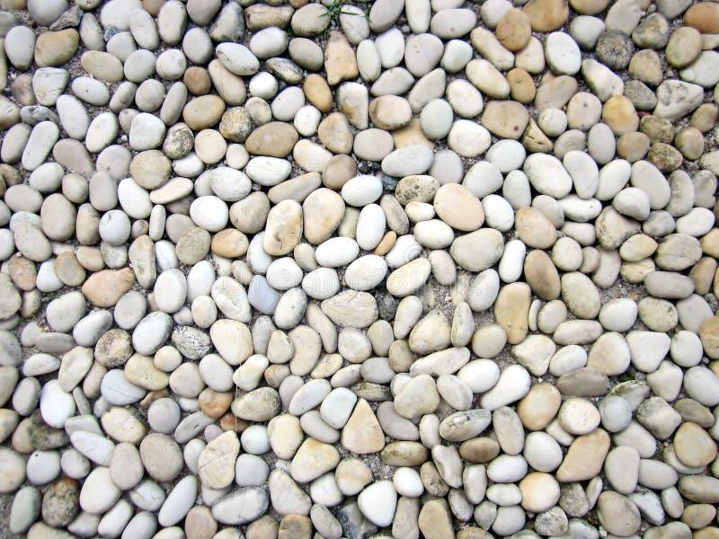 Duizenden kleine ronde stenen stock foto