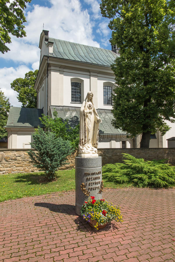 Dukla, Poland - July 20, 2016: Figure inviting Mary to pray the. Rosary in front of the parish church in Dukla, Poland stock photos