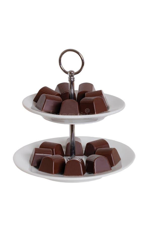 Dulces aislados Primer de dulces en un etagerie aislado en un fondo blanco Fondo de las decoraciones Macro fotografía de archivo libre de regalías