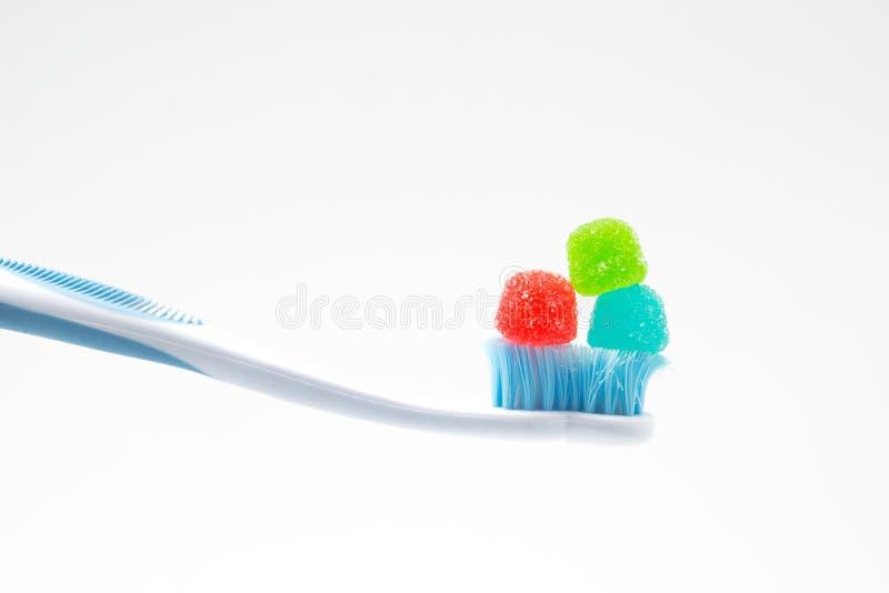 Dulces do engodo de Cepillo de dientes, cuidado de concepto de salud y dental fotografia de stock