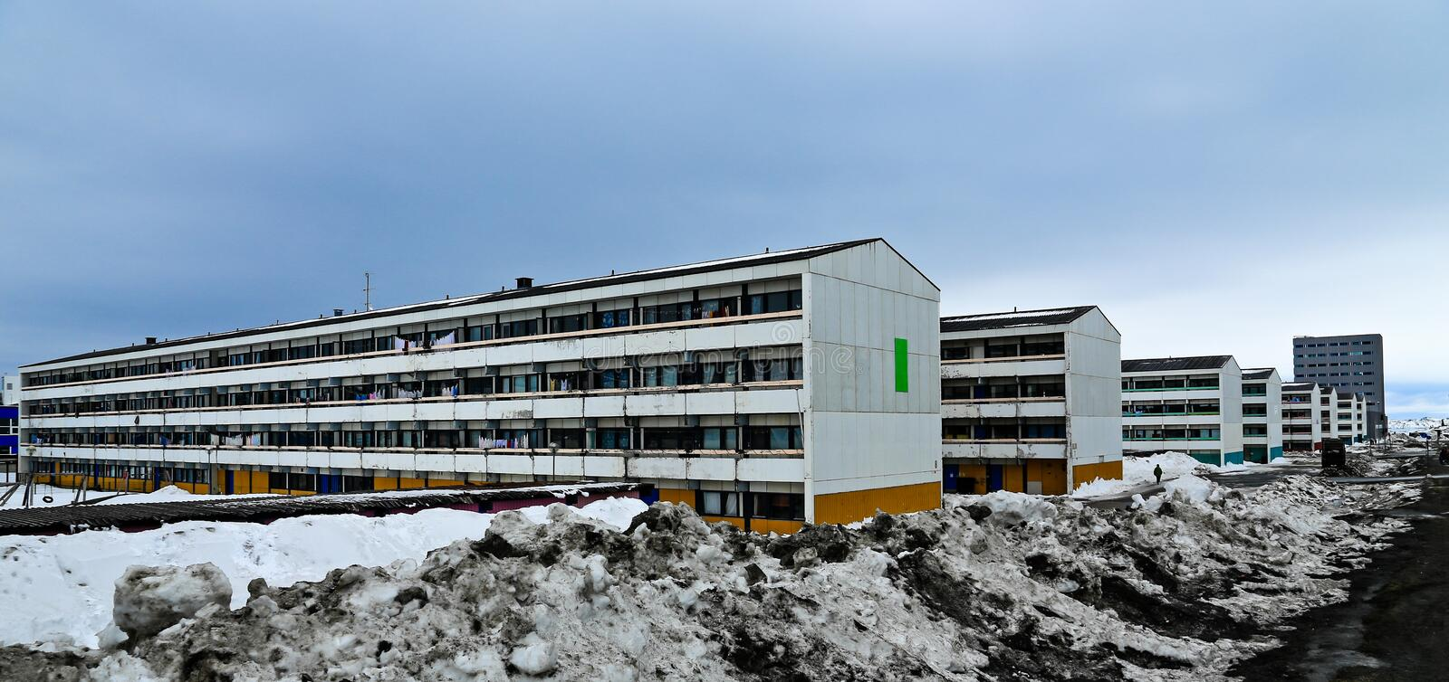 Dull rows of long Inuit living buildings in Arctic capital Nuuk. City, Greenland stock photos