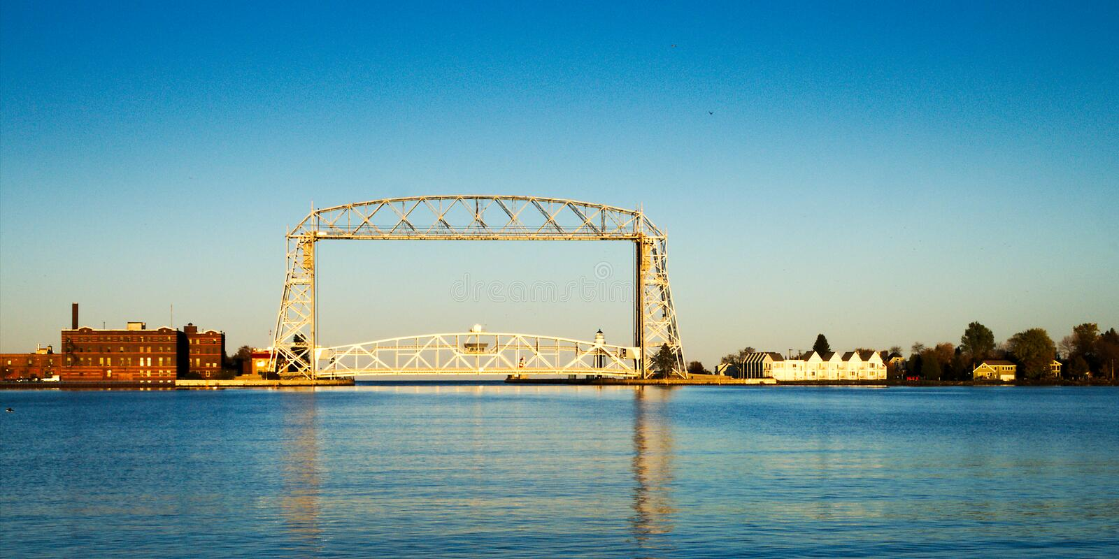 Duluth Minnesota aerial lift bridge in late afternoon from harbor. On sunny day stock images