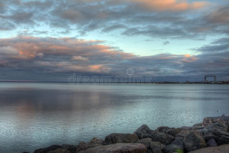 Duluth, Minnesota during a Summer Night at Sunset. A calm summer night at twilight in downtown Duluth harbor, Minnesota, United States stock image