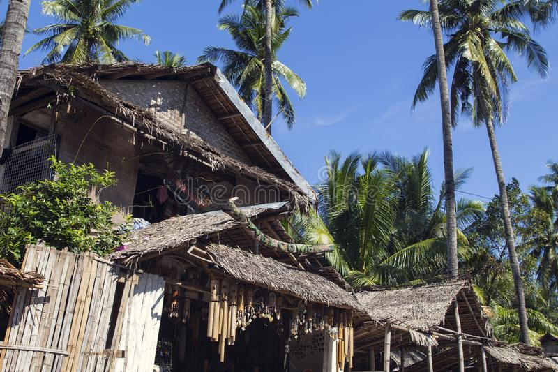 Dumaguete, Philippines - 1 Nov 2017: Souvenir shop with native decoration. Rustic tribal house with dry leaf roof. royalty free stock photo