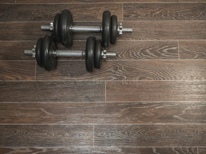 Dumbbell on the floor royalty free stock photo