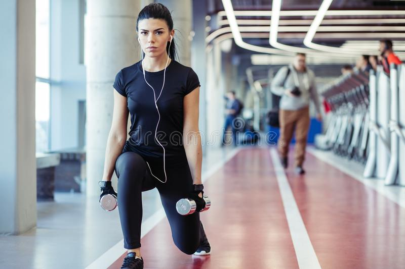 Dumbbell lunge woman workout exercise, one leg split squats royalty free stock photography