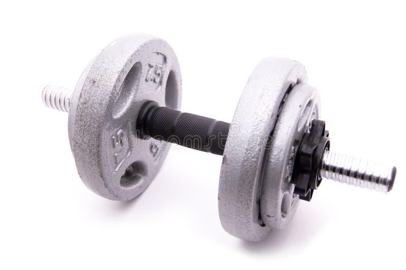 Dumbbell mit vier Gewichten auf Weiß stockfotografie