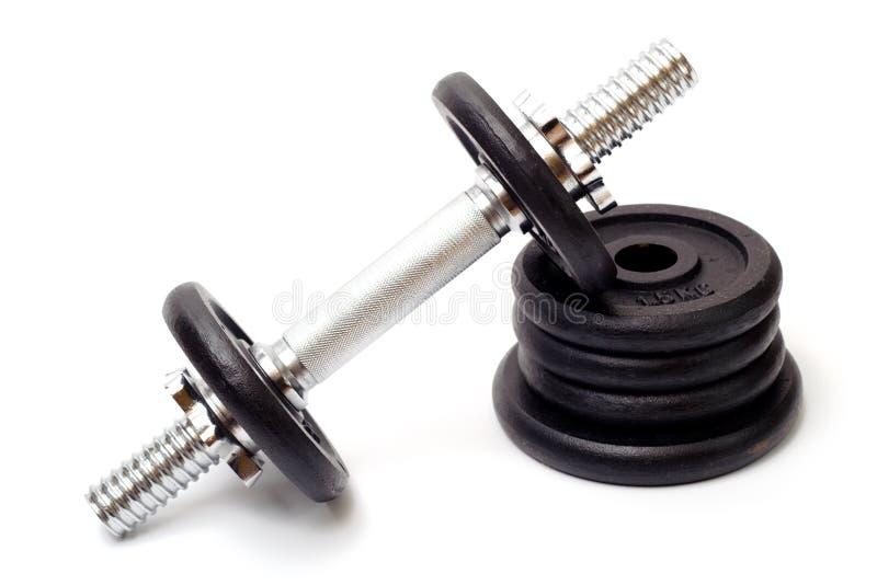 Dumbbell preto, equipamento bodybuilding foto de stock royalty free