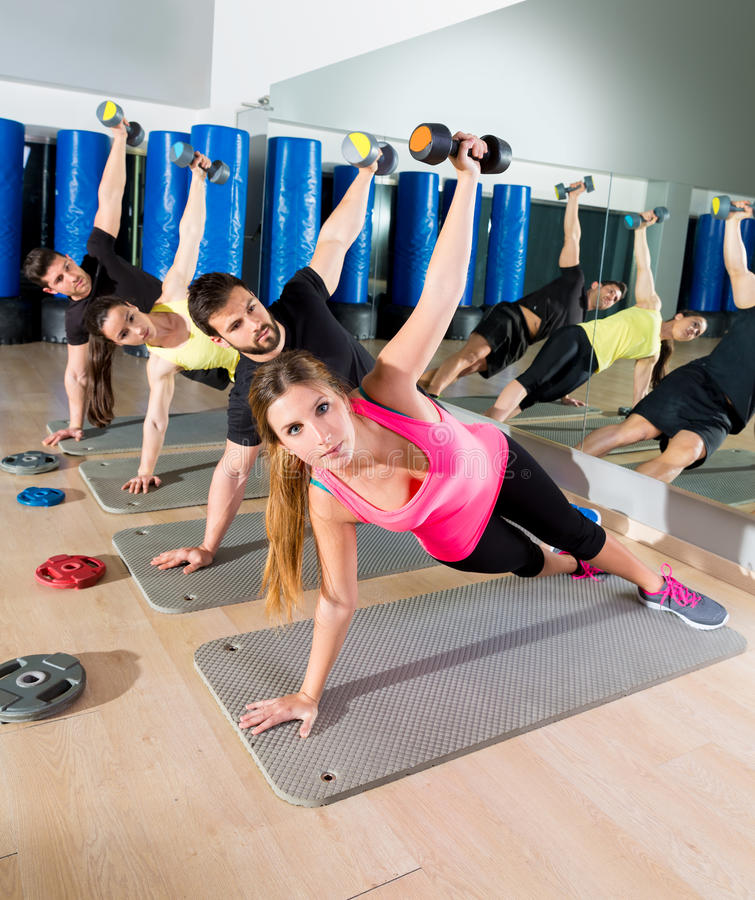 Dumbbell push up group functional training at gym stock photos
