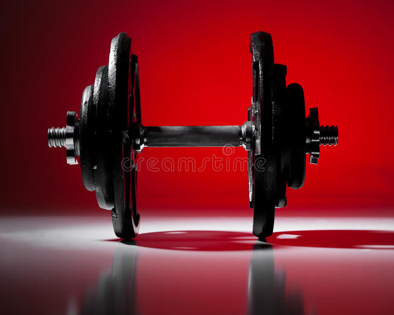Dumbbell on Red royalty free stock photos