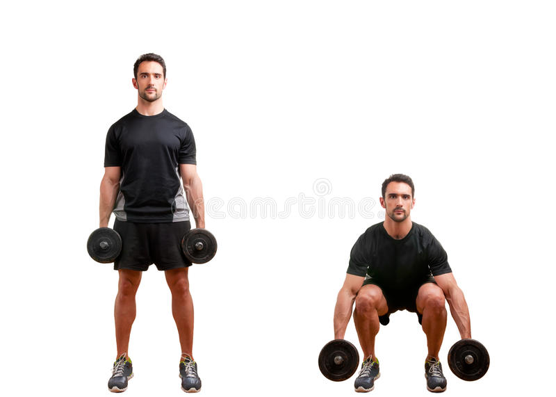 Dumbbell Squat. Personal Trainer doing dumbbell squat for training his legs, isolated in white stock images