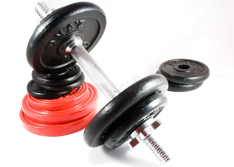 Dumbbell on stack of weights royalty free stock images