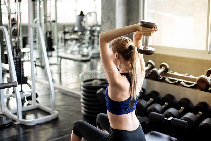 Dumbbell Triceps Extension The Triceps are powerful stock photos