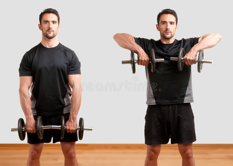 Dumbbell Upright Row. Personal Trainer doing dumbbell upright row for training his deltoids royalty free stock photo