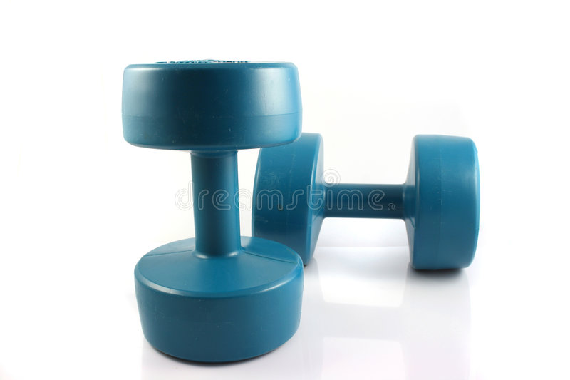 Dumbbells. A set of weight training Dumbbells on a white background royalty free stock images