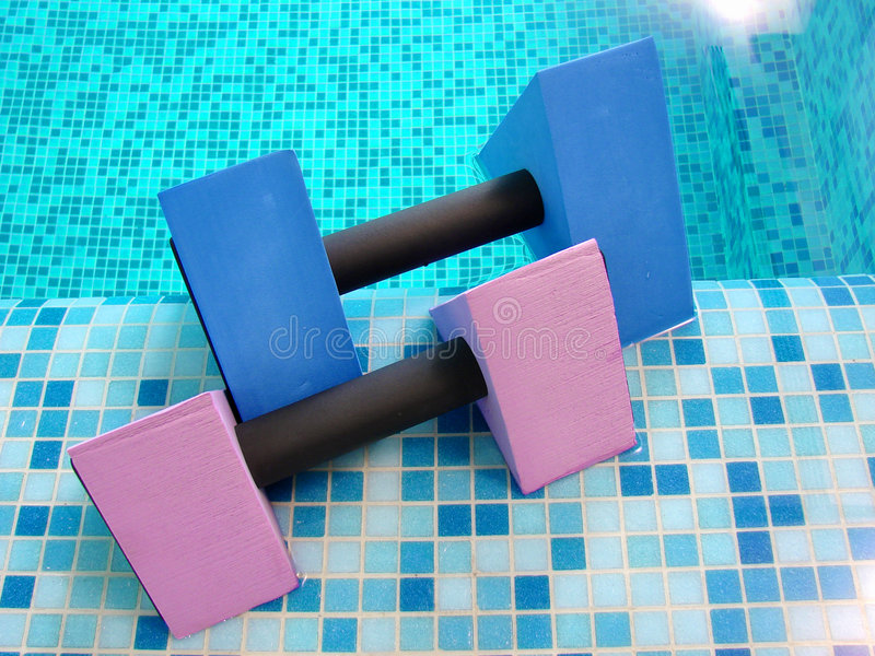 Dumbbells for aqua aerobics royalty free stock images