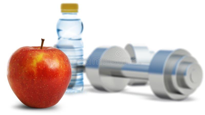Dumbbells com uma maçã fotografia de stock royalty free