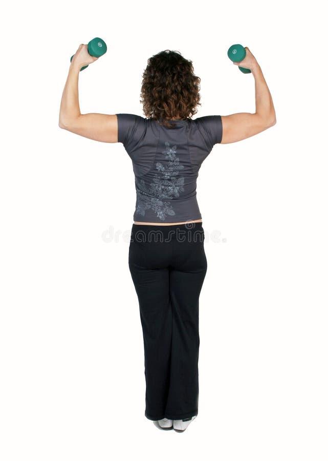 Dumbbells di sollevamento dell'istruttore di forma fisica fotografie stock libere da diritti