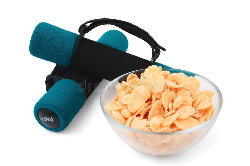 Dumbbells e cornflakes fotografia de stock