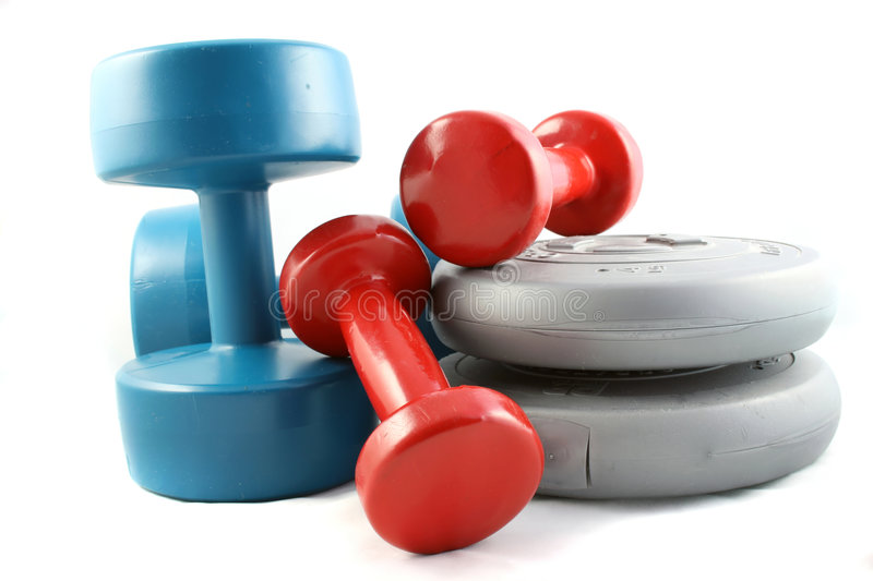 Dumbbells and Free Weights. A set of weight training Dumbbells and weights on a white background stock photo