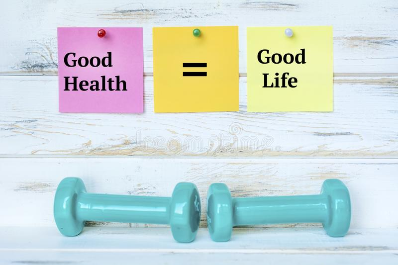Dumbbells and Good Health is equal to Good Life Notes royalty free stock photography
