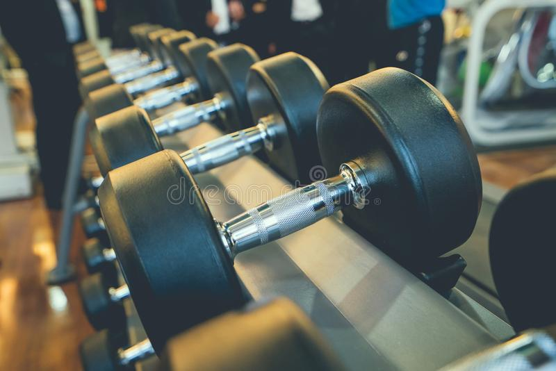 Dumbbells in the gym at sports club for exercise and Bodybuilding.  royalty free stock photo