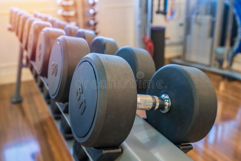 Dumbbells in the gym at sports club for exercise and Bodybuilding.  stock images
