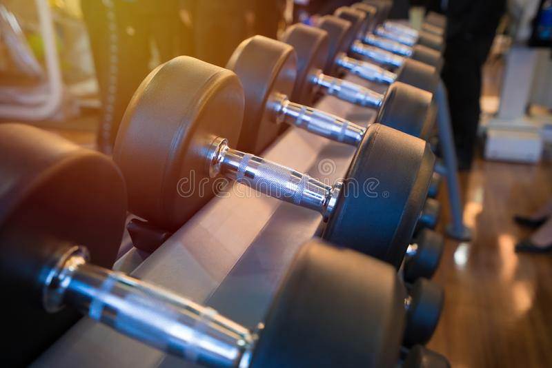 Dumbbells in the gym at sports club for exercise and Bodybuilding.  royalty free stock photography