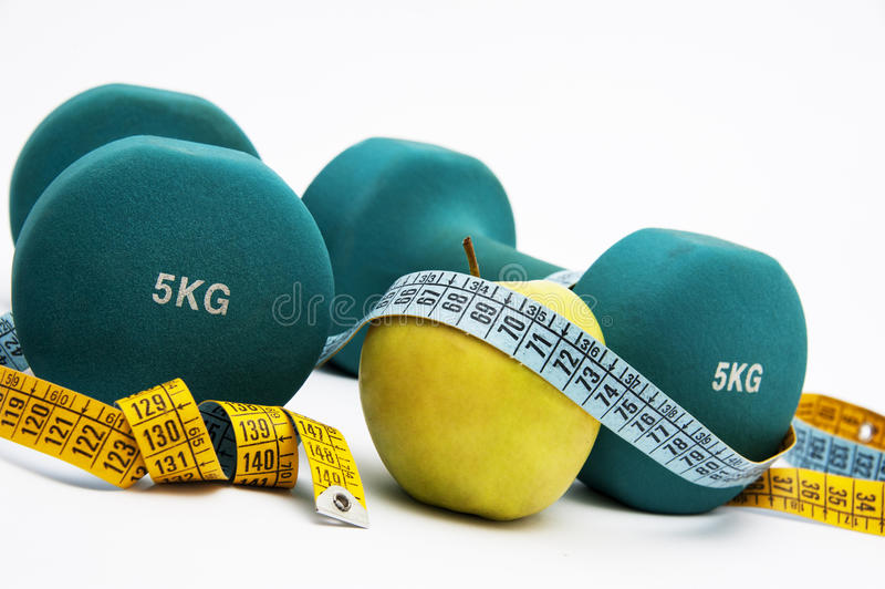 Dumbbells And Measure Tape Royalty Free Stock Image
