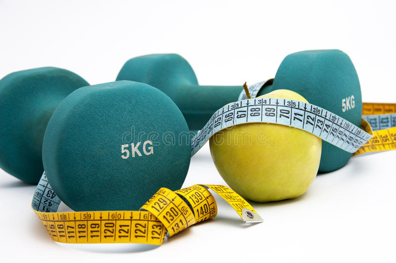 Dumbbells And Measure Tape Stock Photo
