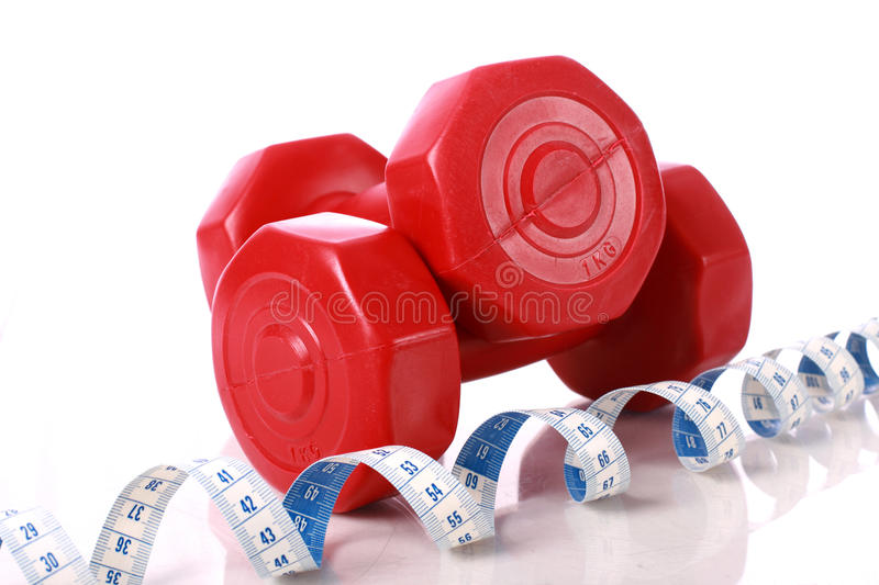 Dumbbells And Measuring Tape. Royalty Free Stock Photos