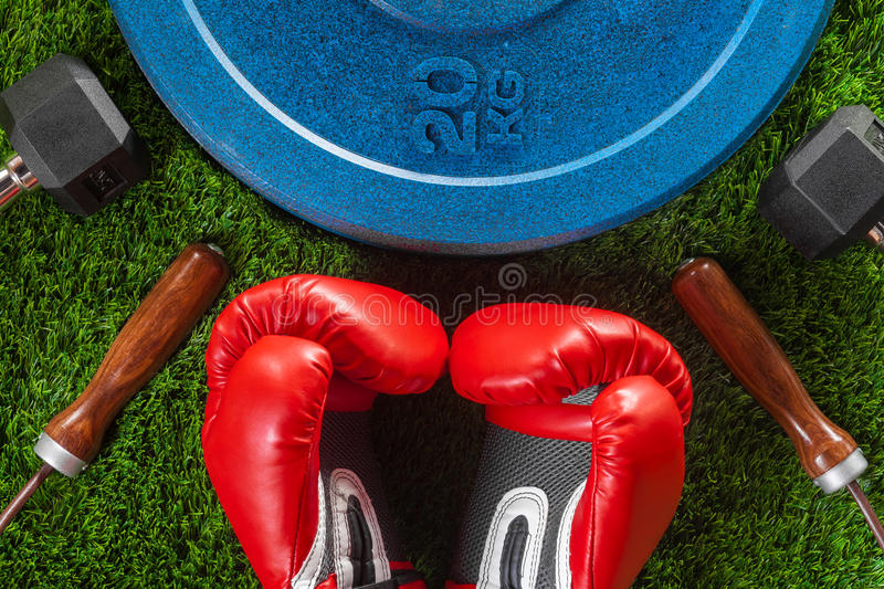 Dumbbells, skipping rope, boxing gloves and weight royalty free stock photos